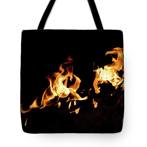 Flames In The Fire Of A Red And Yellow Barbecue. Tote Bag