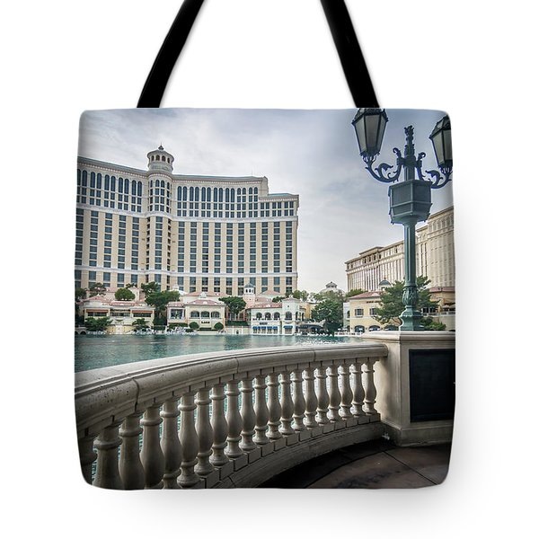 Tote Bag featuring the photograph Bellagio Hotel And Other Architecture In Las Vegas Nevada by Alex Grichenko