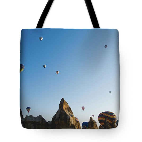 Colorful Balloons Flying Over Mountains And With Blue Sky Tote Bag