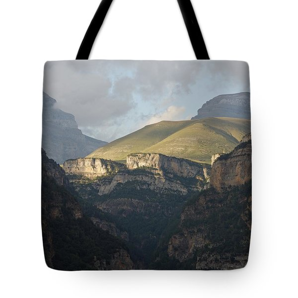 Tote Bag featuring the photograph A Dash Of Light In The Canyon Anisclo by Stephen Taylor