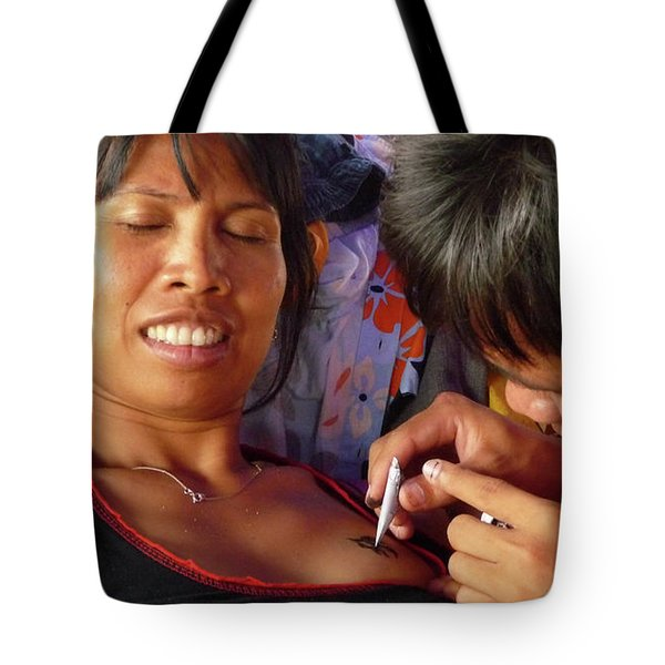 Tote Bag featuring the photograph A Fun Tattoo by Jeremy Holton