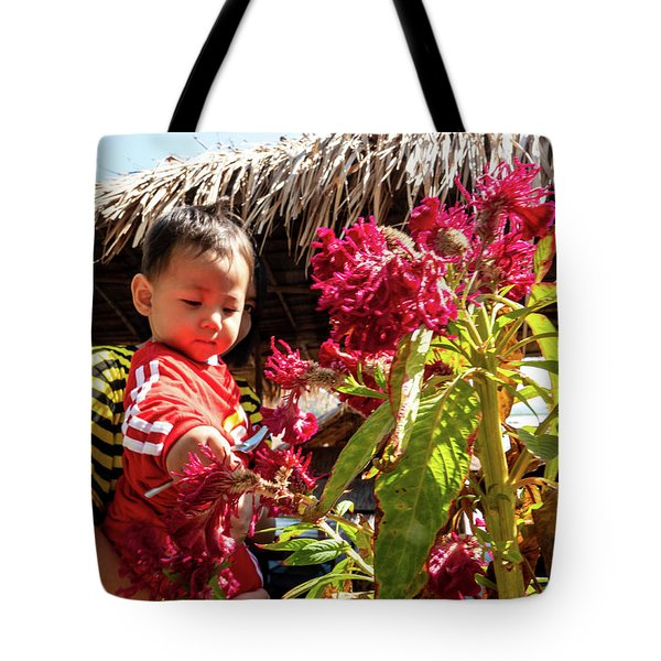 A Small Person With Reflected Flowers Tote Bag