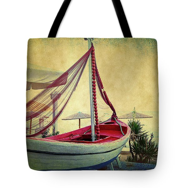 Tote Bag featuring the photograph an Old Boat by Milena Ilieva