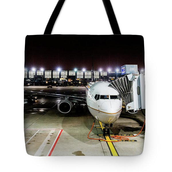 Tote Bag featuring the photograph Arrivals And Departure On Airplane At The Airport by Alex Grichenko