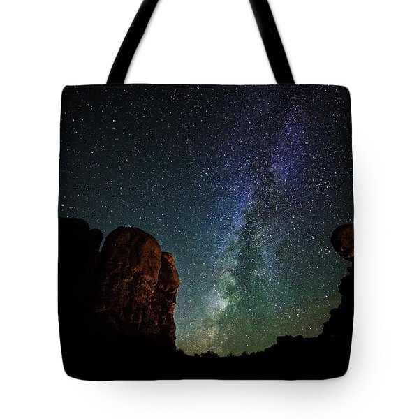 Tote Bag featuring the photograph Balancing Act by Andy Crawford