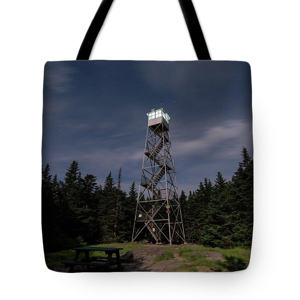 Tote Bag featuring the photograph Balsam Lake Mountain Firetower Moonlight by Brad Wenskoski