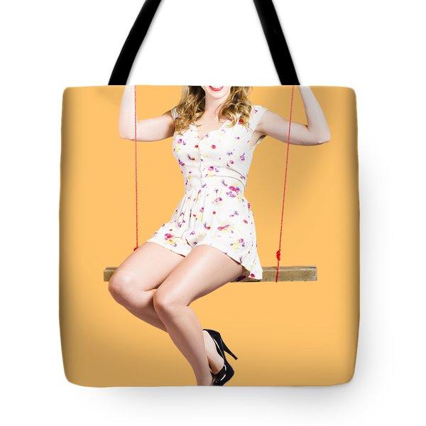 Beautiful Fifties Pin Up Girl Smiling On Swing Tote Bag