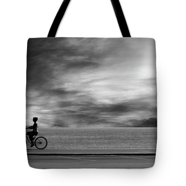 Tote Bag featuring the photograph Biking On Pch by John Rodrigues