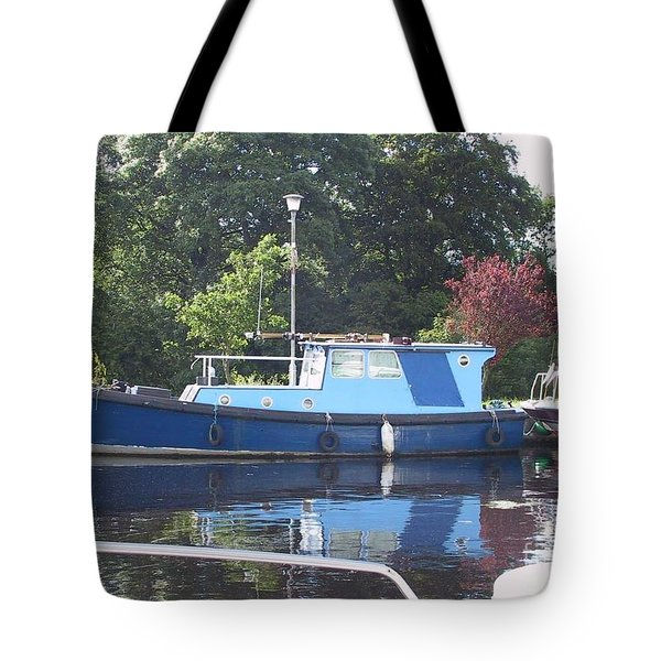 Tote Bag featuring the painting Blue Boat At Cloondara Harbour. by Val Byrne