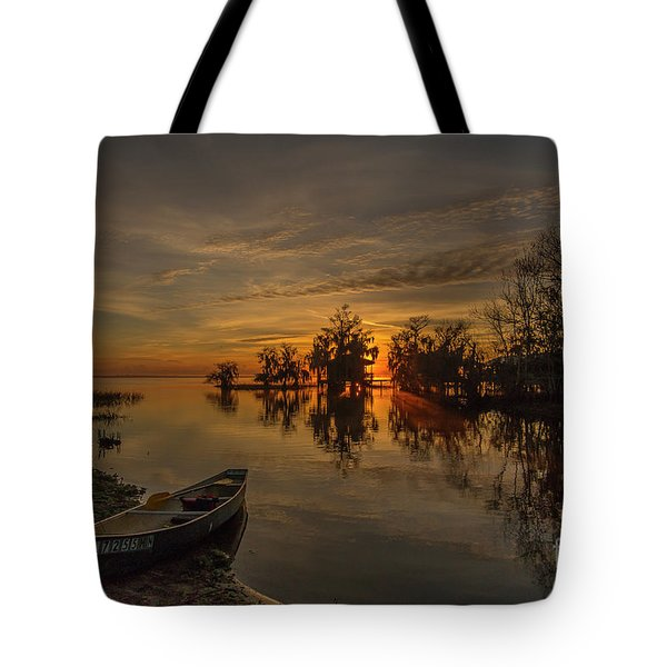 Tote Bag featuring the photograph Blue Cypress Canoe by Tom Claud