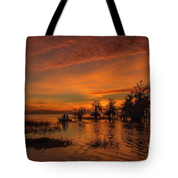 Tote Bag featuring the photograph Blue Cypress Sunrise With Boat by Tom Claud