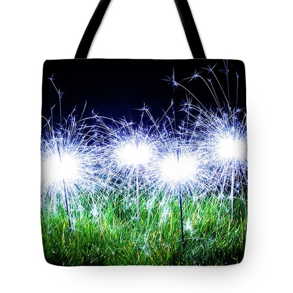 Tote Bag featuring the photograph Blue Sparklers In The Grass by Scott Lyons