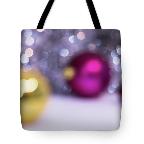Tote Bag featuring the photograph Blurry Christmas Background With Christmas Balls And Bokeh by Cristina Stefan