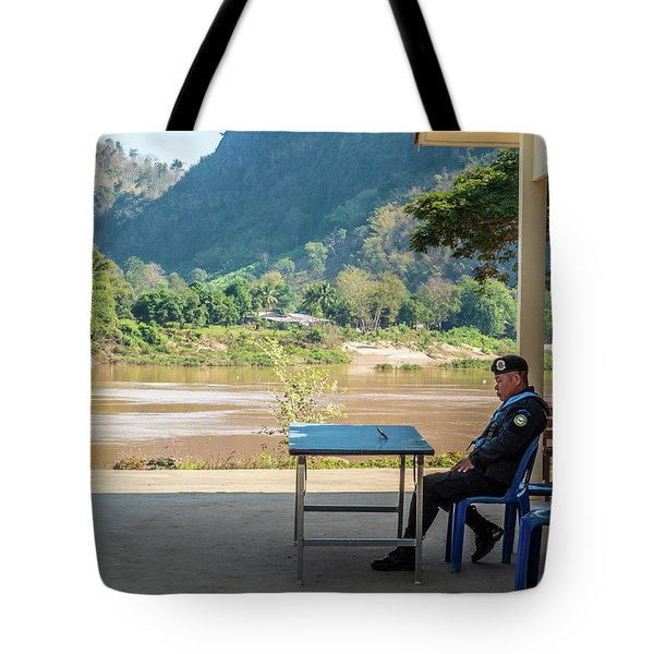 Tote Bag featuring the photograph Border Guard Hard At Work by Jeremy Holton