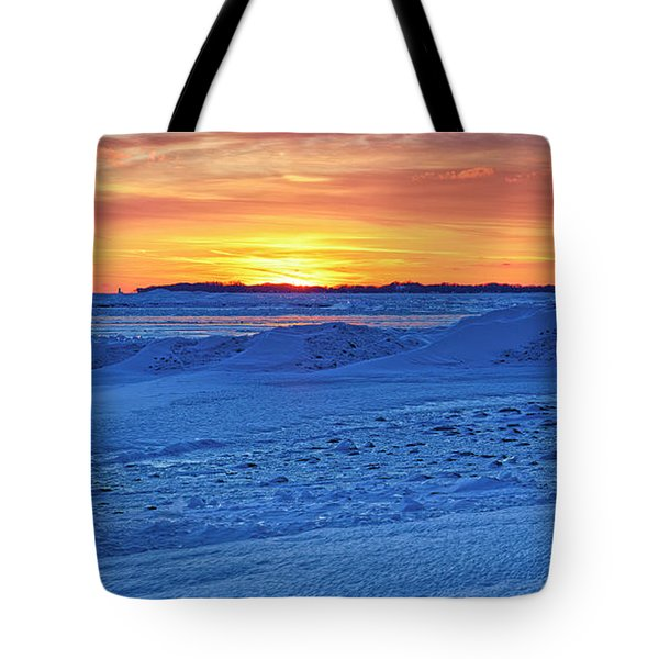 Bright Sunset Over Frozen Waves Tote Bag