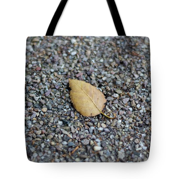 Tote Bag featuring the photograph Brown Leaf On Gravel by Scott Lyons