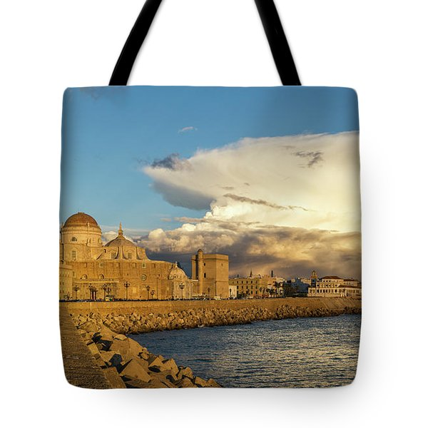Tote Bag featuring the photograph Cadiz Skyline And Cathedral Under Cumulonimbus by Pablo Avanzini