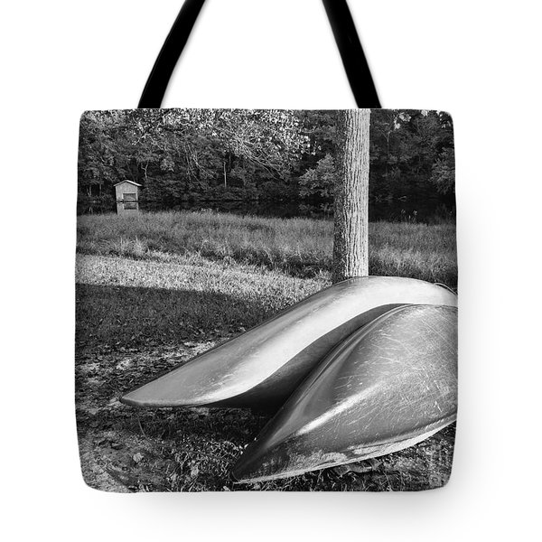 Tote Bag featuring the photograph Canoes And A Boathouse Bnw by Rachel Hannah