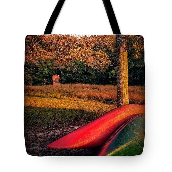 Tote Bag featuring the pyrography Canoes And A Boathouse by Rachel Hannah