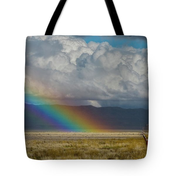 Tote Bag featuring the photograph Carrizo Rainbow And Fence by Matthew Irvin