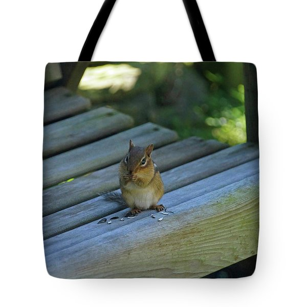 Tote Bag featuring the photograph Chipmunk Eating Seeds by Angela Murdock