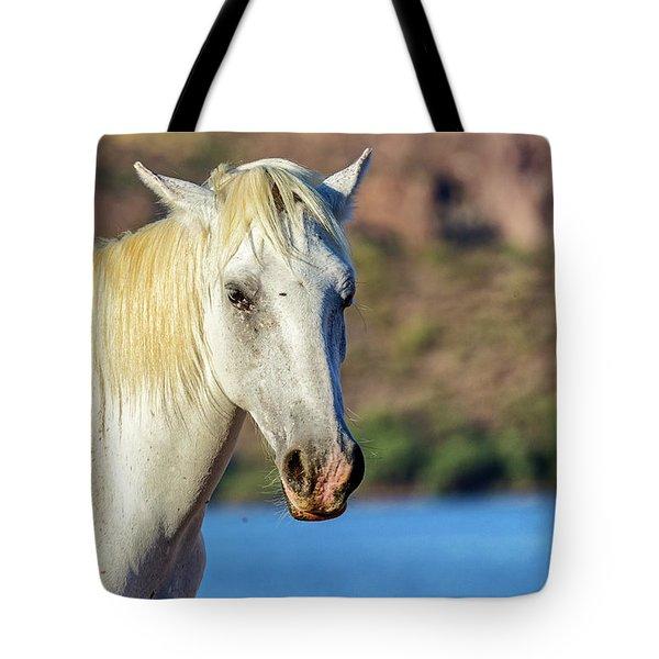 Closeup White Wild Horse With Lake Background Tote Bag