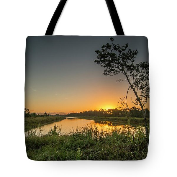 Tote Bag featuring the photograph Cloudless Hungryland Sunrise by Tom Claud