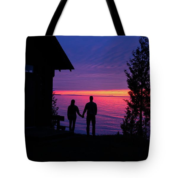 Tote Bag featuring the photograph Couple At Sunset by Paul Schultz