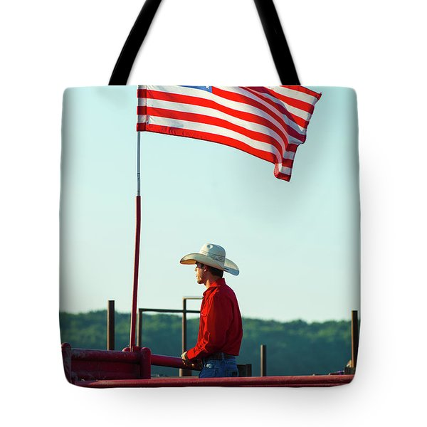 Tote Bag featuring the photograph Cowboy And American Flag by Dennis Dame