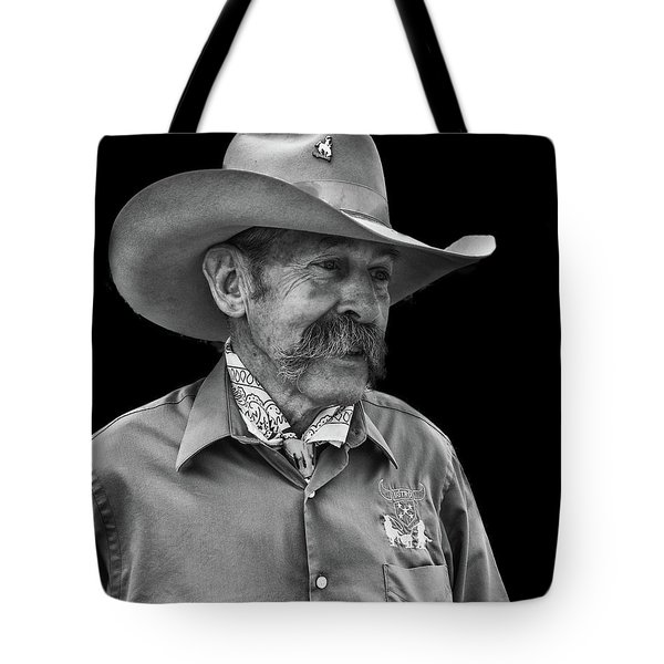 Tote Bag featuring the photograph Cowboy by Jim Mathis