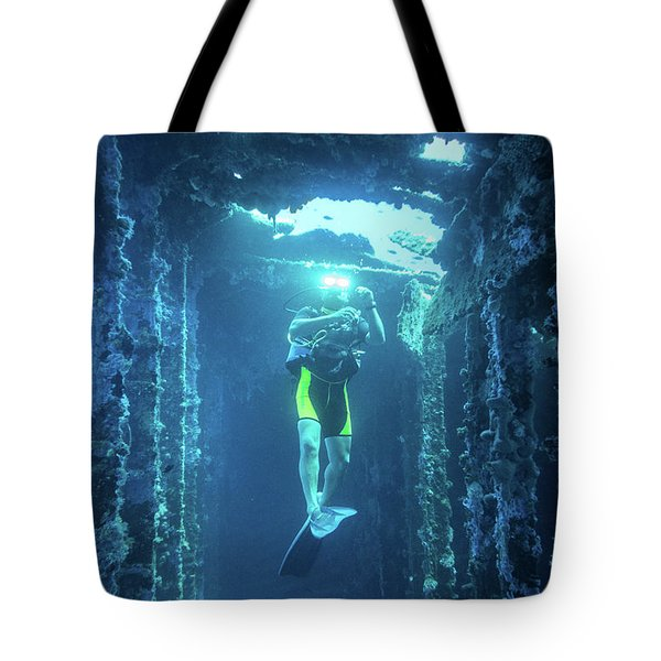Tote Bag featuring the photograph Diver In The Patris Shipwreck by Milan Ljubisavljevic