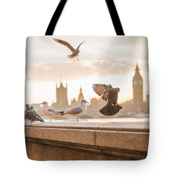 Tote Bag featuring the photograph Doves And Seagulls Over The Thames In London by Top Wallpapers