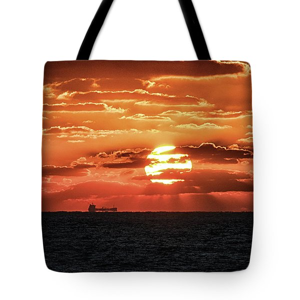 Tote Bag featuring the photograph Dramatic Atlantic Sunrise With Ghost Freighter by Bill Swartwout Fine Art Photography