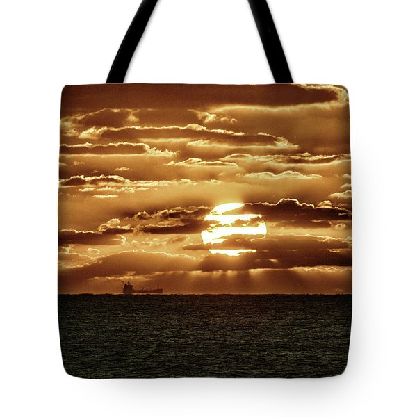 Tote Bag featuring the photograph Dramatic Atlantic Sunrise With Ghost Freighter In Goldtone by Bill Swartwout Fine Art Photography