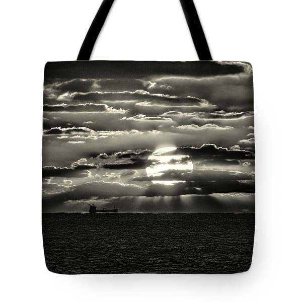 Tote Bag featuring the photograph Dramatic Atlantic Sunrise With Ghost Freighter In Monochrome by Bill Swartwout Fine Art Photography