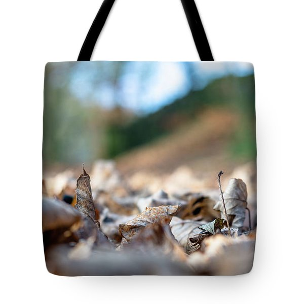 Tote Bag featuring the photograph Dried Leaves On The Ground by Scott Lyons