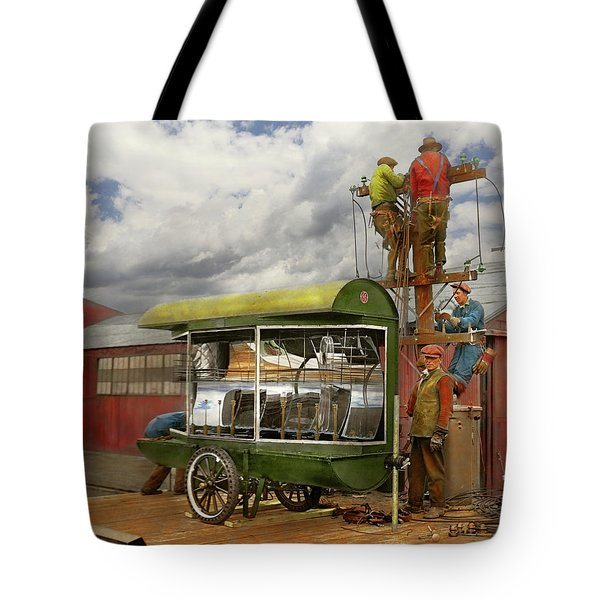 Tote Bag featuring the photograph Electrician - Linemen - Installing Search Lights 1929 by Mike Savad