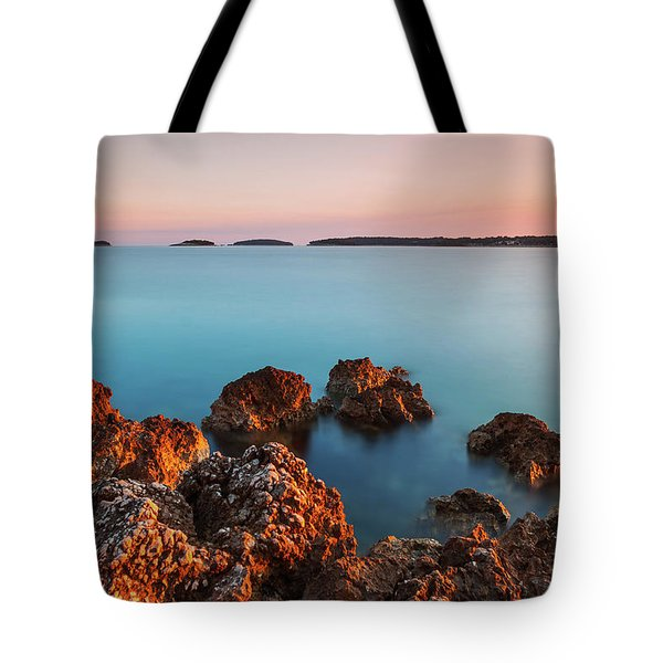 Tote Bag featuring the photograph Ember And Blue by Davor Zerjav