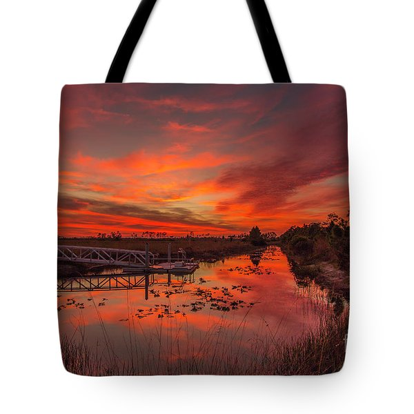 Tote Bag featuring the photograph Explosive Sunset At Pine Glades by Tom Claud