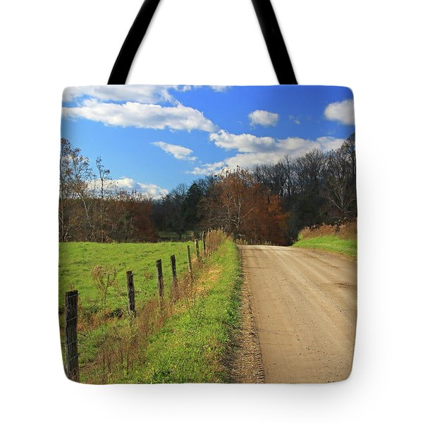 Tote Bag featuring the photograph Fence And Country Road by Angela Murdock
