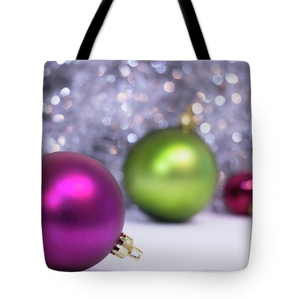 Tote Bag featuring the photograph Festive Scene For Christmas With Xmas Balls And Lights In Backgr by Cristina Stefan