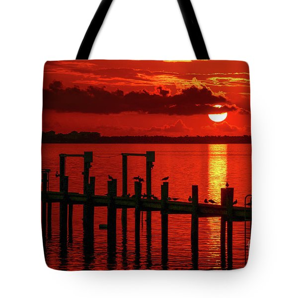 Tote Bag featuring the photograph Fireball And Pier Sunrise by Tom Claud