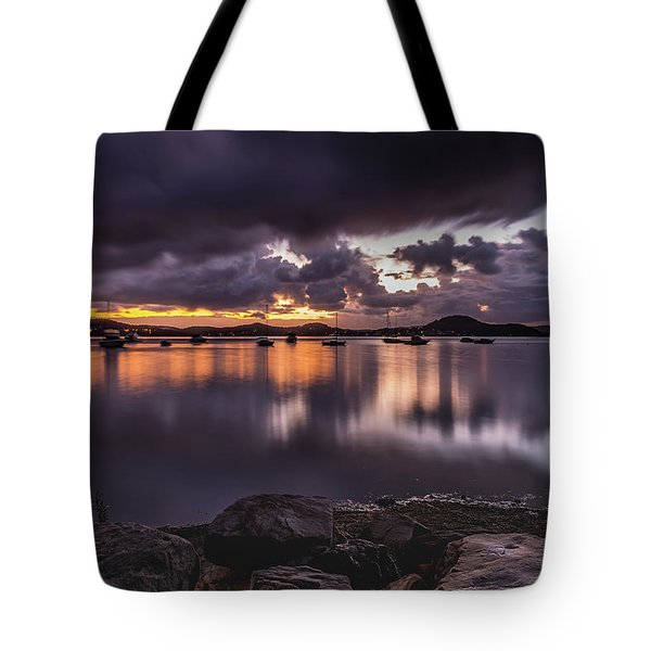 First Light With Heavy Rain Clouds On The Bay Tote Bag