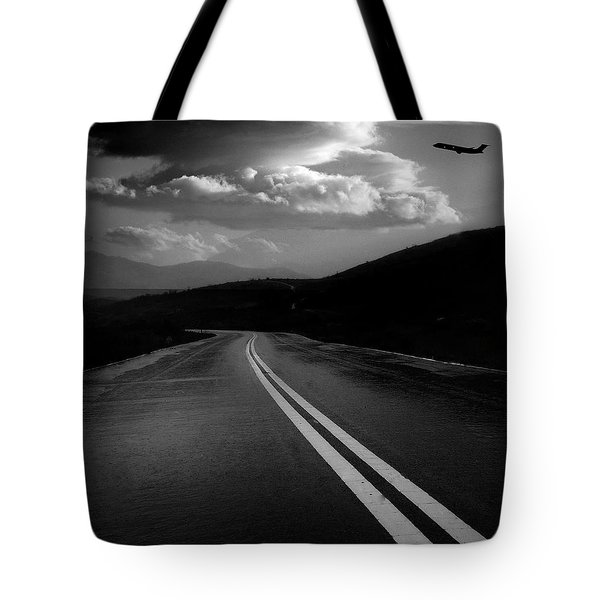 Tote Bag featuring the photograph Flight Path by John Rodrigues
