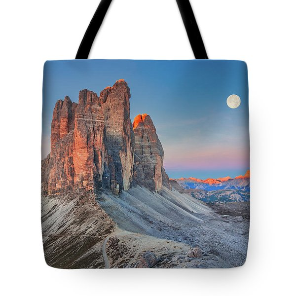 Tote Bag featuring the photograph Full Moon Morning On Tre Cime Di Lavaredo by Dmytro Korol
