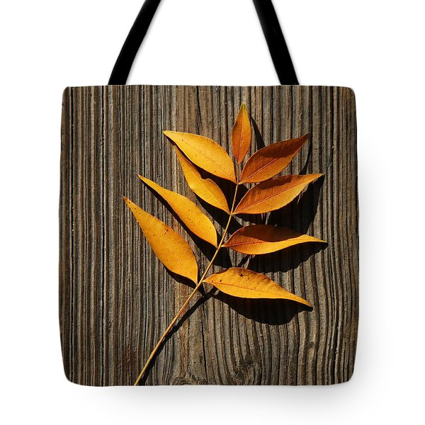 Tote Bag featuring the photograph Golden Autumn Leaves On Wood by Debi Dalio