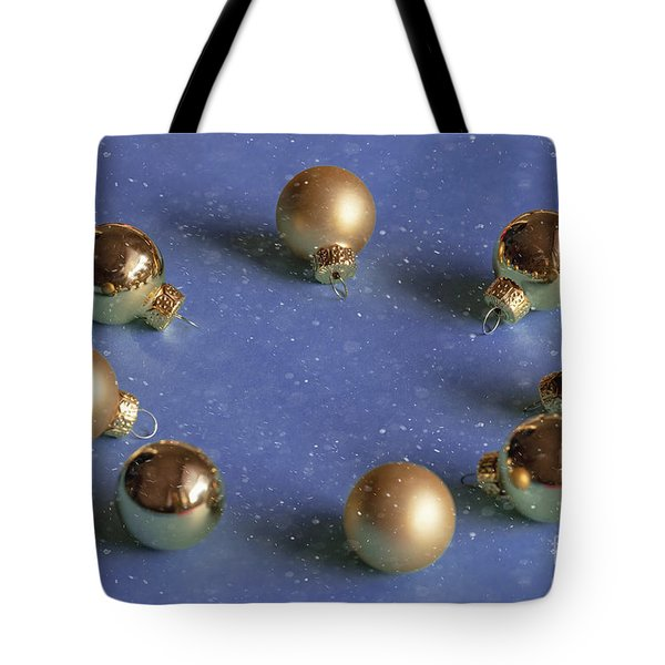 Golden Christmas Balls On The Snowy Background Tote Bag