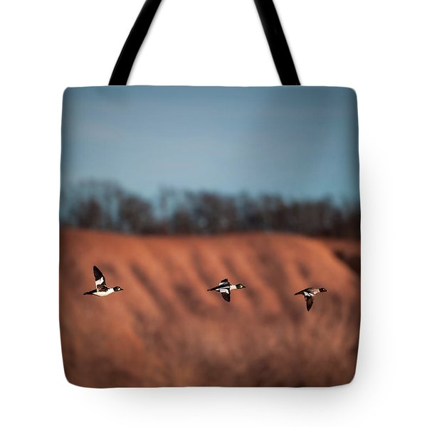 Tote Bag featuring the photograph Golden Eye by Jeff Phillippi