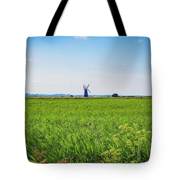 Tote Bag featuring the photograph Green Grass Field With Windmill On Horizon by Scott Lyons