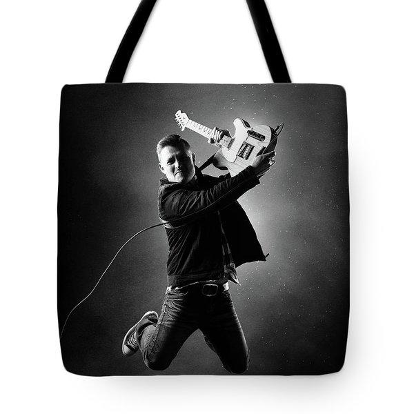 Guitarist Jumping High Tote Bag
